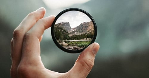 Using a lens to magnify and focus