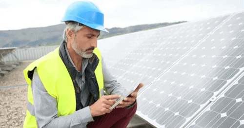 Government contractor works on solar panel