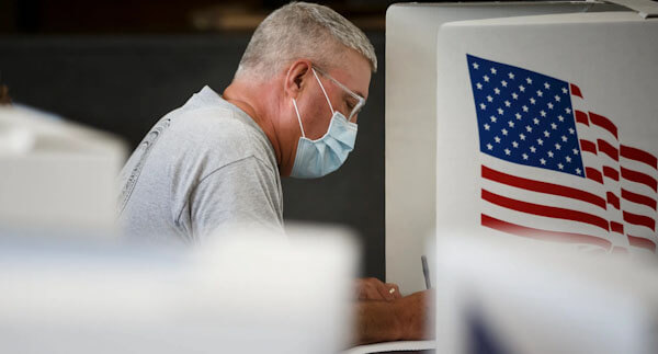 Man Voting in Mask   CSG Partners
